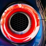 A sports car tail light is illuminated