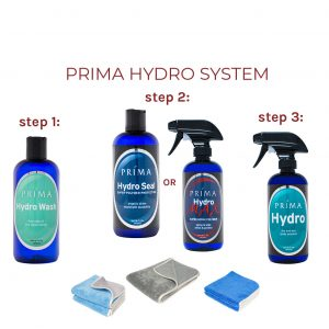 Four bottles of Prima Car Care products are displayed with a blank background and three microfiber towels