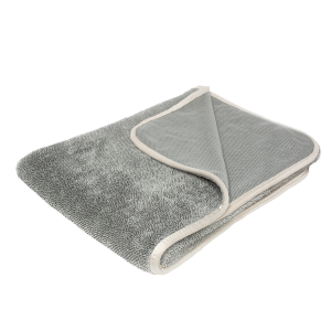 A grey microfiber towel is displayed with a blank background