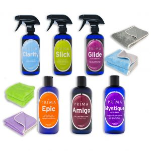 Six bottles of Prima Car Care products are displayed with a blank background and four microfiber towels