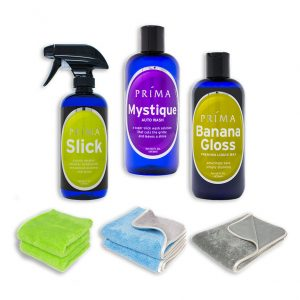 Three bottles of Prima Car Care products are displayed with a blank background and three microfiber towels