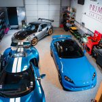 Three sports cars sit in a shop